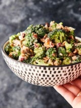 bowl of broccoli salad held