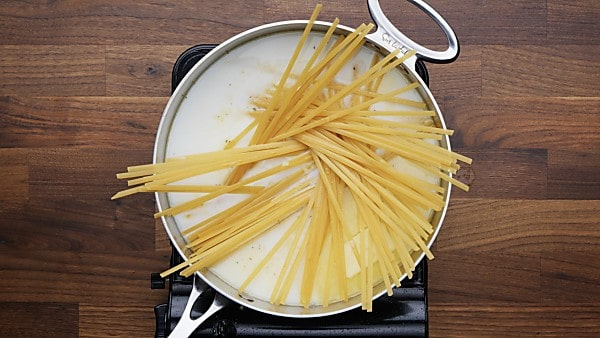 pasta and liquids in pan
