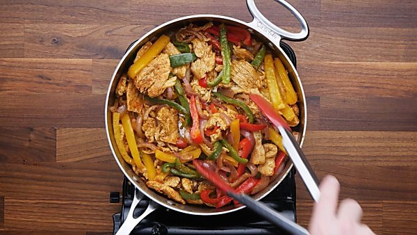 chicken and veggies mixed in saute pan
