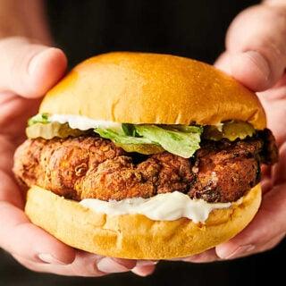 chicken sandwich held two hands