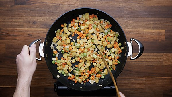 carrot, celery, and onion sauteed in skillet