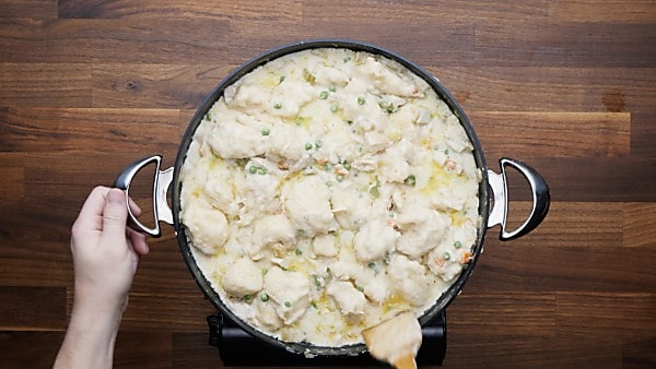 finished chicken and dumplings in saute pan