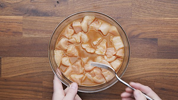 chicken in marinade in bowl