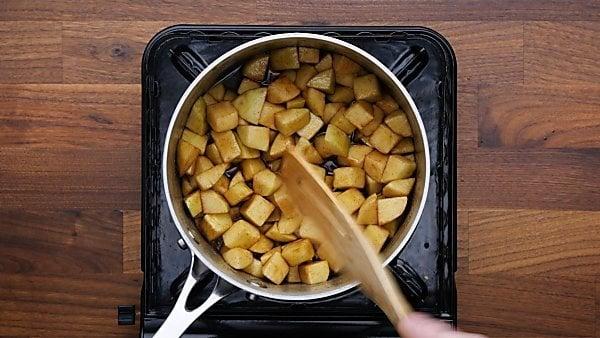 filling ingredients in saucepan