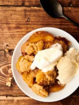 plate of peach cobbler above