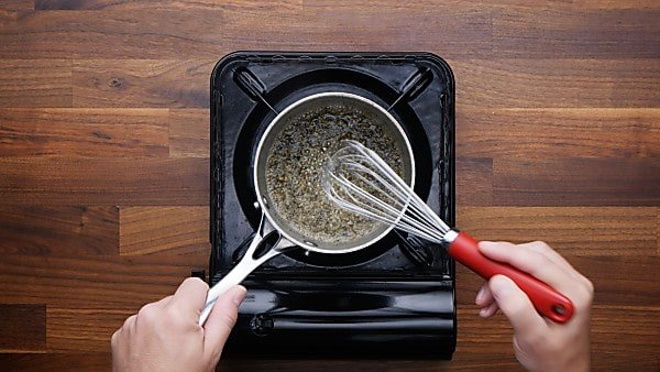 spices and butter whisked in saucepan