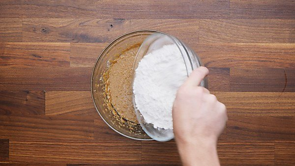 dry ingredients being poured into wet mixture
