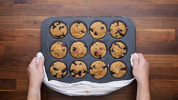finished blueberry muffins in muffin tin