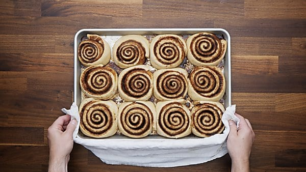 baked cinnamon rolls on baking sheet