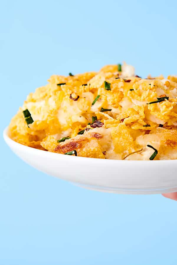 plate of hashbrown casserole blue background