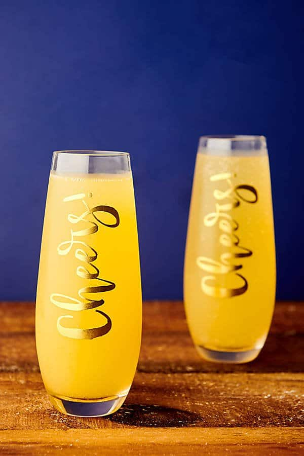 two mimosa glasses on table
