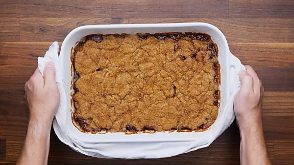 finished peach cobbler in baking dish