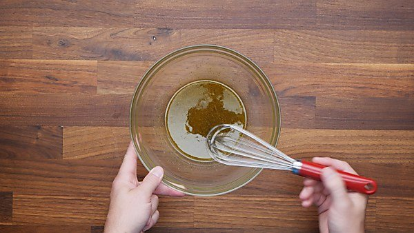 marinade being whisked in mixing bowl