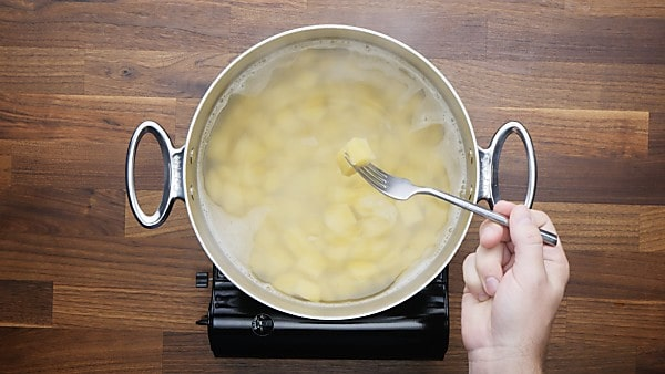 cubed potatoes in stockpot