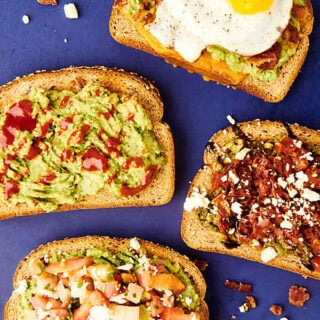 four pieces of avocado toast above