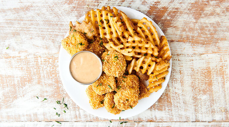 chick fil a sauce on plate with waffle fries and chicken nuggets