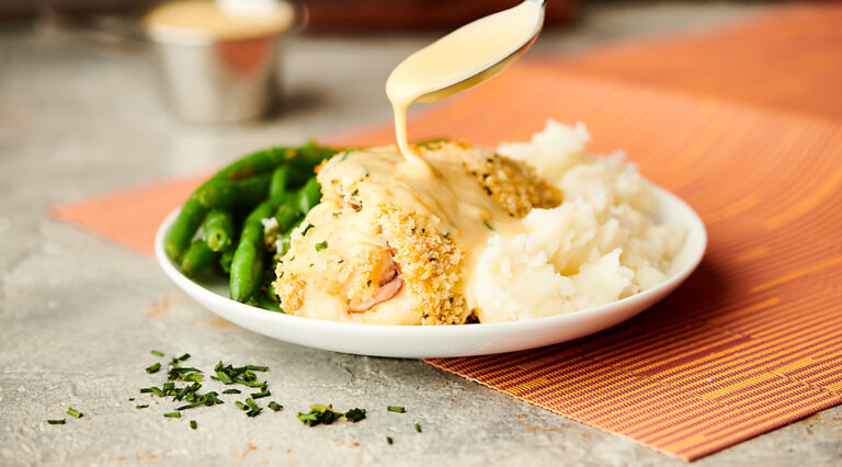 chicken cordon bleu on plate with rice and green beans