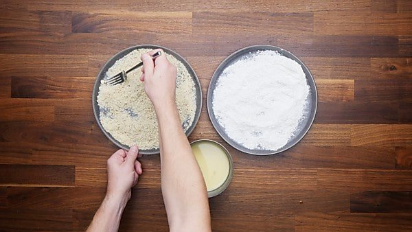 flour, egg, and breadcrumbs in 3 separate dishes
