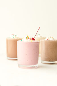 four milkshakes in cups