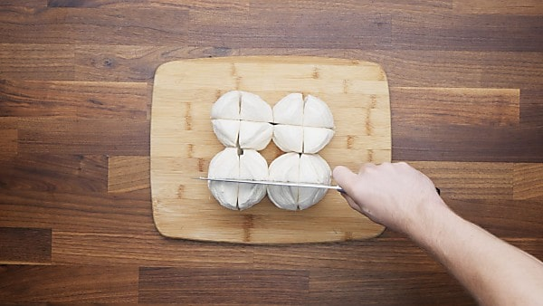 biscuit dough being cut into quarters