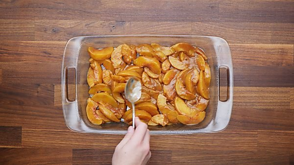 peach mixture in baking dish