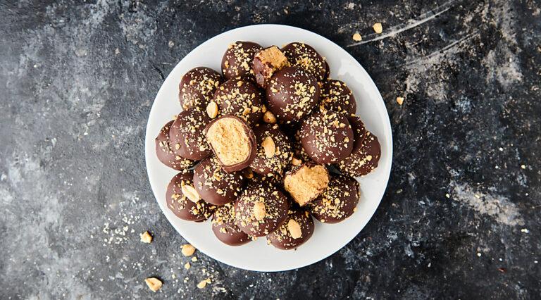 peanut butter balls on plate above