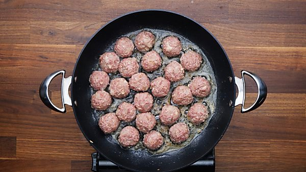 meatballs being cooked in skillet