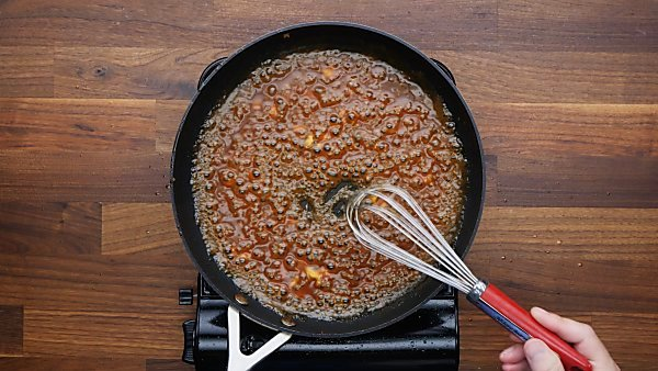 cornstarch slurry added to teriyaki sauce in skillet