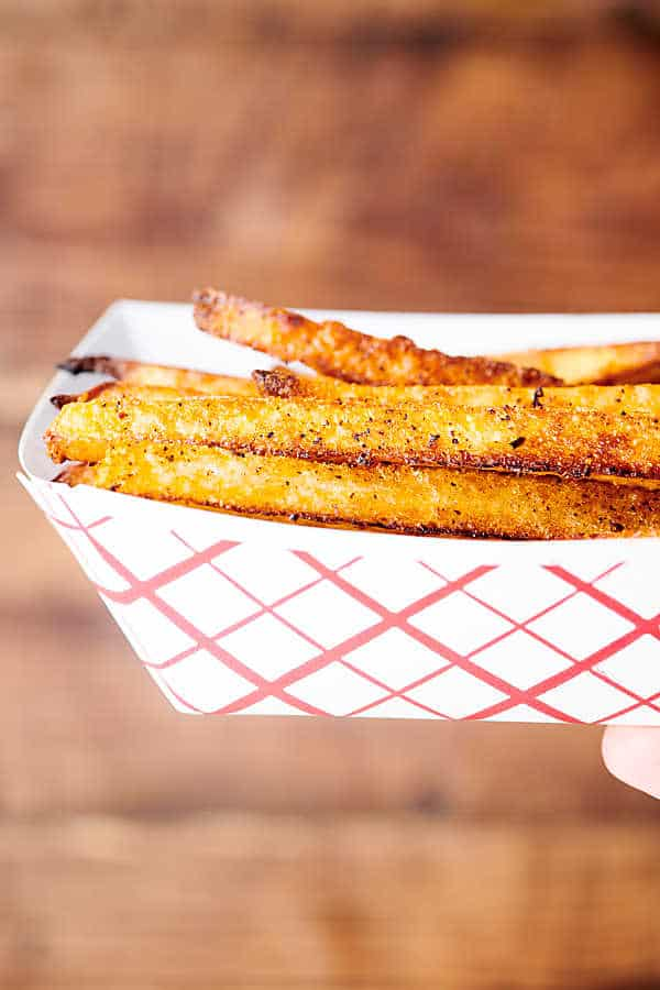 paper dish of air fryer french fries held