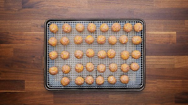 sausage balls on baking sheet uncooked
