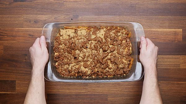 topping over apple mixture in baking dish