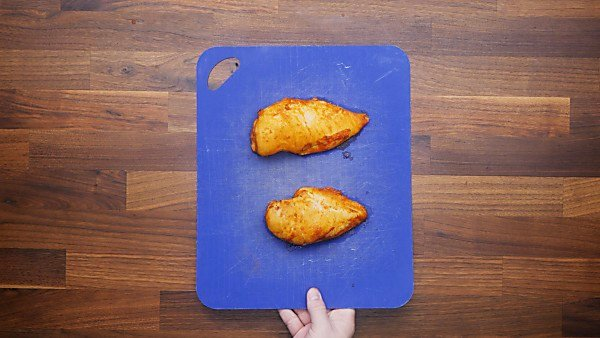 baked chicken on cutting board