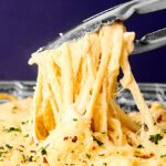 chicken tetrazzini being served with tongs