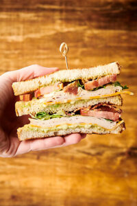 two halves of club sandwich held