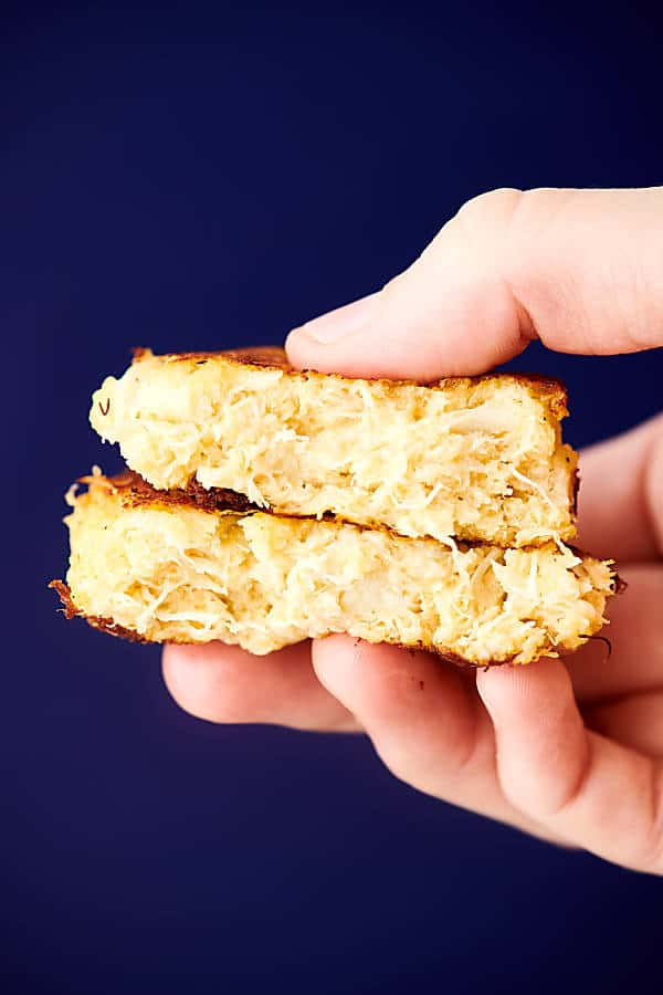 two halves of crab cake stacked and held