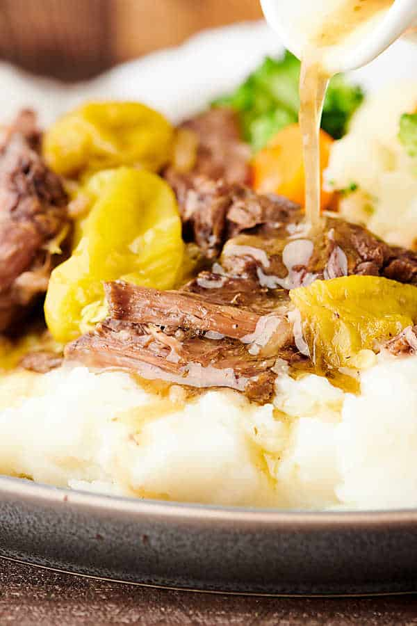 closeup of mississippi roast on plate with mashed potatoes