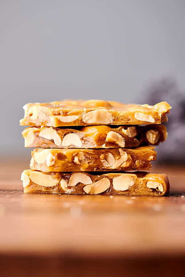 four pieces of peanut brittle stacked
