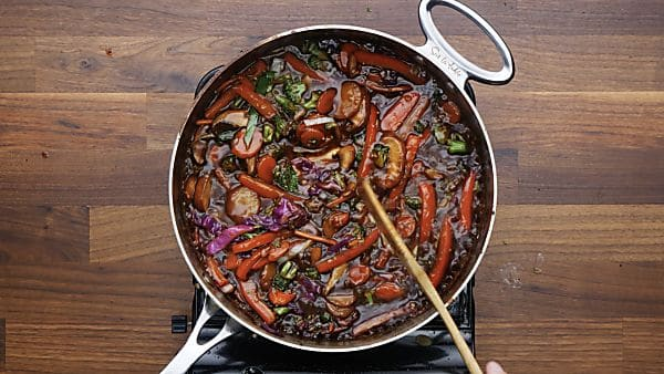 sauce with veggies in saute pan