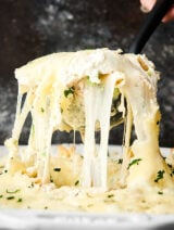 chicken alfredo bake being scooped with ladle