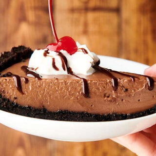 slice of chocolate pudding pie on plate held