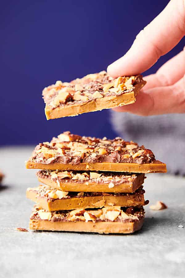 heath bars stacked, one being lifted off