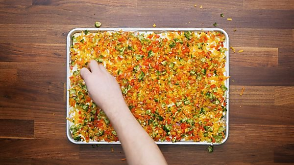 veggies layered on pizza