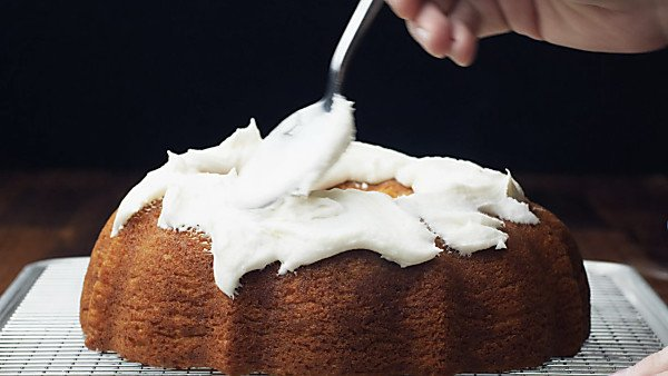 7up pound cake being frosted with spoon