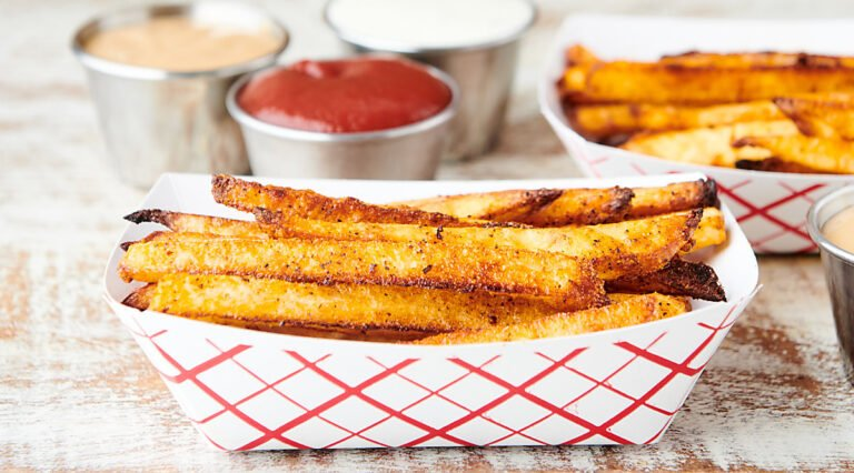 air fryer french fries in paper dish side view