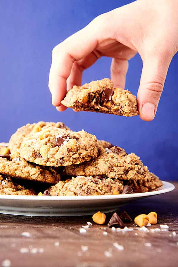 plate of almond flour oatmeal cookies, one being lifted off