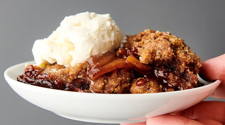plate of apple cobbler with ice cream