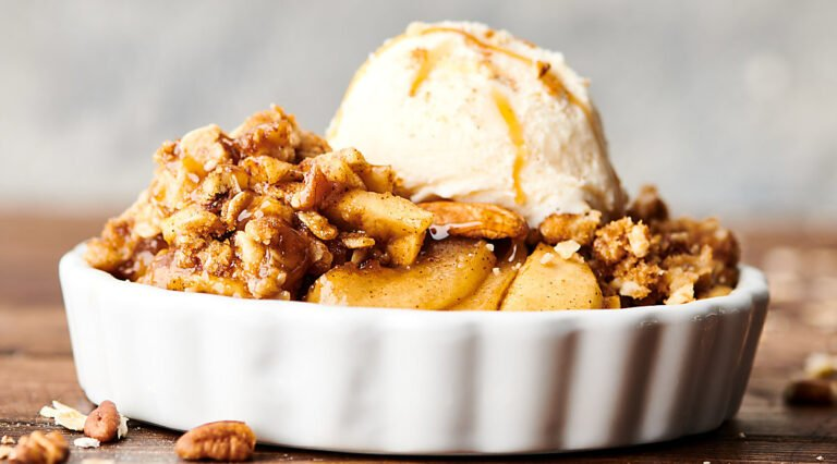 bowl of apple crisp with scoop of ice cream
