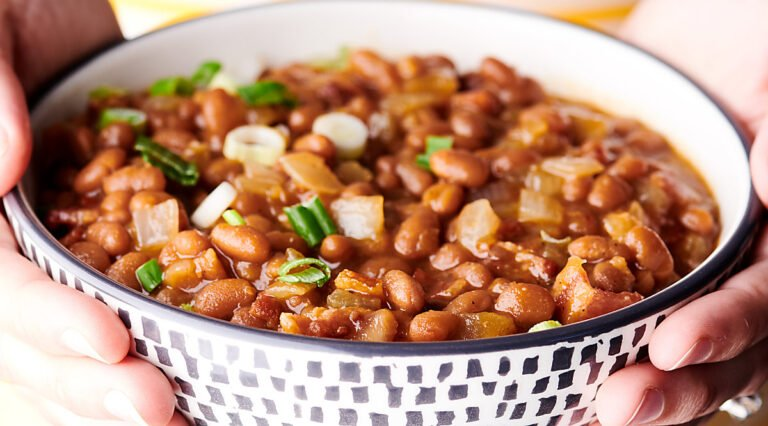 bowl of bbq baked beans held two hands