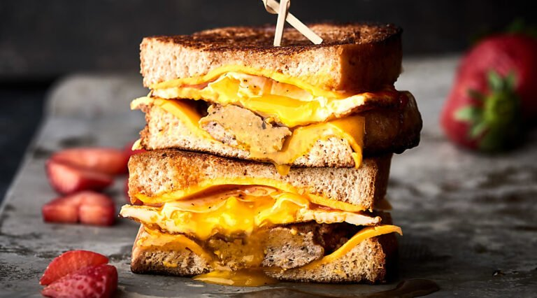two halves of breakfast grilled cheese sandwich stacked