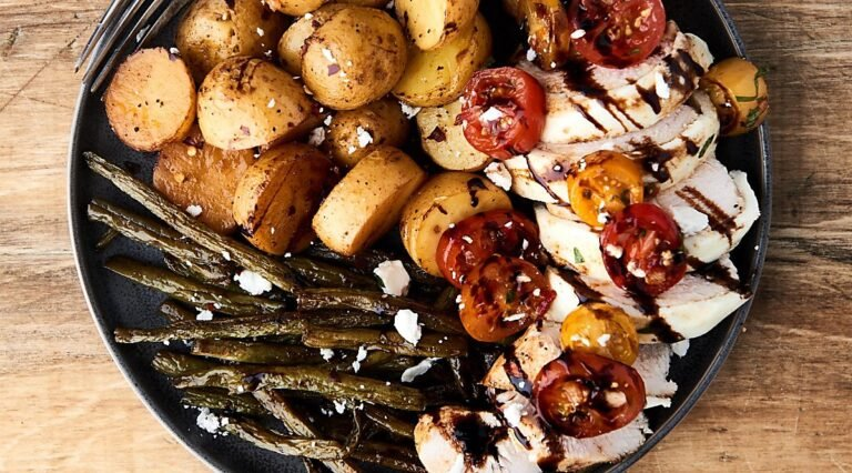 bruschetta chicken on plate with potatoes and green beans above